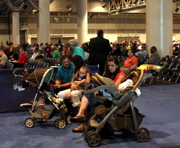 "Parents watch the convention proceedings from the ""stroller section,"" a cordoned-off area for families with young children."