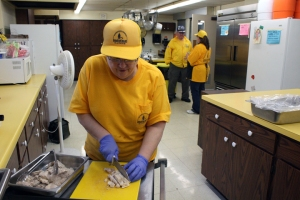 Disaster Relief volunteer Betty Stone prepares meals to be delivered to victims of recent flooding in Illinois.