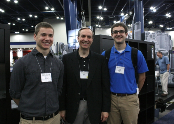 IBSA Executive Director Nate Adams (center) visited the exhibits at Houston's George R. Brown Convention Center with his sons, Ethan (left) and Noah.