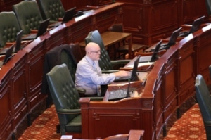 Rep. Greg Harris was the lone legislator on the floor before Friday's session began. Harris, who is gay and living with HIV, is the same-sex marriage bill's House sponsor.