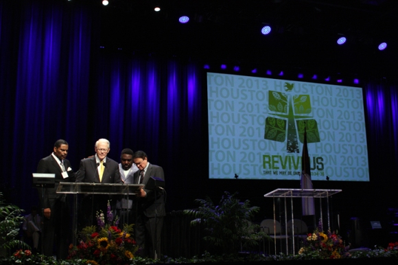 Reflecting his desire for greater ethnic representation in the Southern Baptist Convention, Executive Committee President Frank Page prays with African American and Asian leaders during his report.