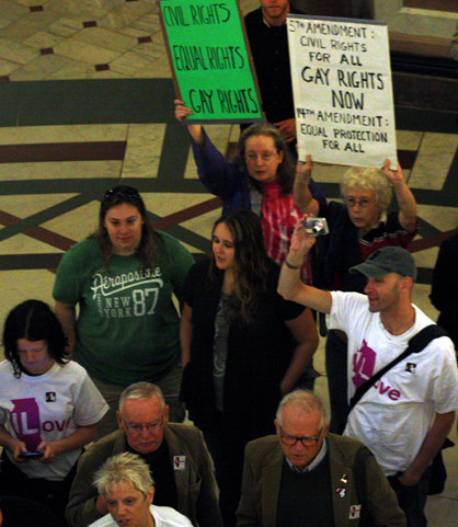 """Same-sex marriage supporters, some wearing """"ILove"""" T-shirts, gathered in the Capitol's rotunda in anticipation of a vote Friday, May 31."""