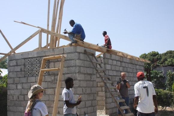 Preparing to put a roof on one of the new houses.