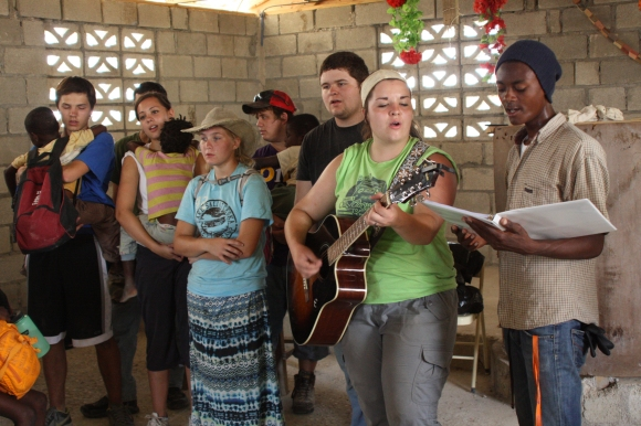 One day after lunch, Sarah Harriss led worship songs with her guitar.