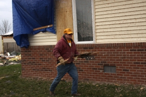 Disaster Relief volunteer Dave Weger from Sullivan, Ill., clears debris from a backyard in Washington.