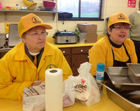 Kitchen volunteers starting preparing meals Monday evening, working out of Woodland Baptist in Peoria. The church has graciously rearranged schedules and plans to accommodate the storm response teams.