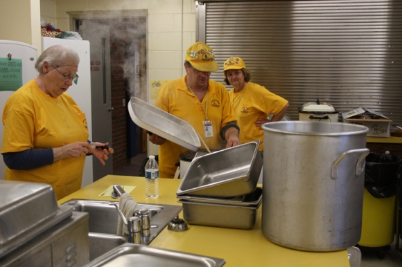 Disaster Relief volunteers working at Woodland Baptist in Peoria prepare a chili dinner for storm responders and victims.