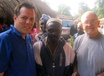 IBSA's Mark Emerson (left) and Harold Booze from Woodland Baptist in Peoria (right) stand with a village chief in West Africa.