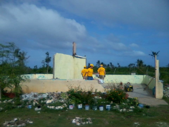 Six Illinois volunteers, arriving in the Philippines this week, will help rebuild this school on Gibitngil Island.