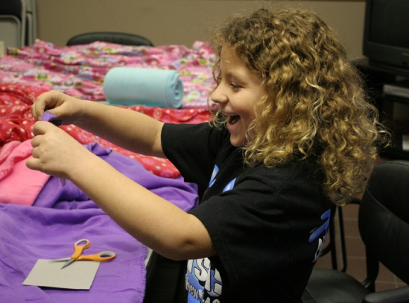 Jaide Soppe, 8, makes a fleece blanket for a Springfield shelter on Children's Ministry Day March 15.