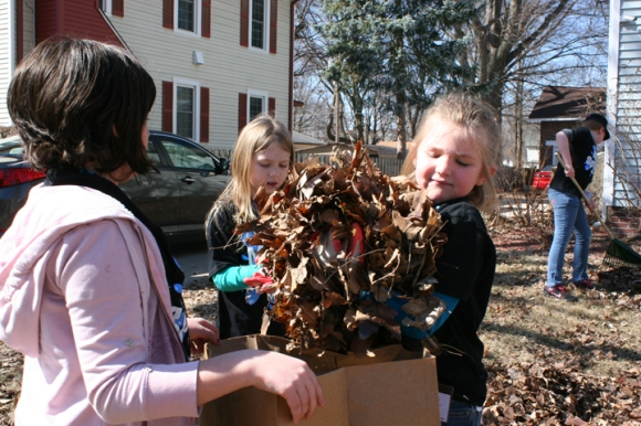 Young volunteers from Calvary Baptist Church in Pittsfield do yard work outside a crisis nursery facility in Springfield. Nearly 1,100 volunteers participated in Children's Ministry Day on March 15.
