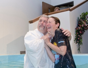 Sarah Schultz rejoices with Skip Leininger, associate pastor of FBC O'Fallon, after being baptized at the church's March 29-30 crusade.
