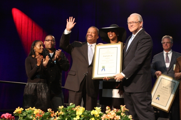 Page presented a plaque of appreciation to Luter, on stage with his wife, Elizabeth, son and daughter-in-law.