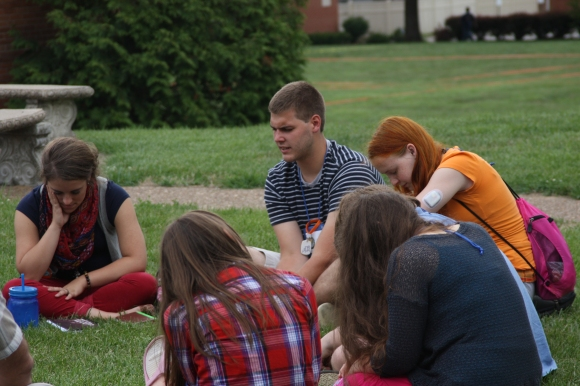 "Students meet in their ""family group"" at Super Summer, IBSA's discipleship week for students in Greenville, Ill."