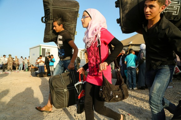 Syrian refugees cross the border from Syria to Jordan. IMB photo by Jedediah Smith