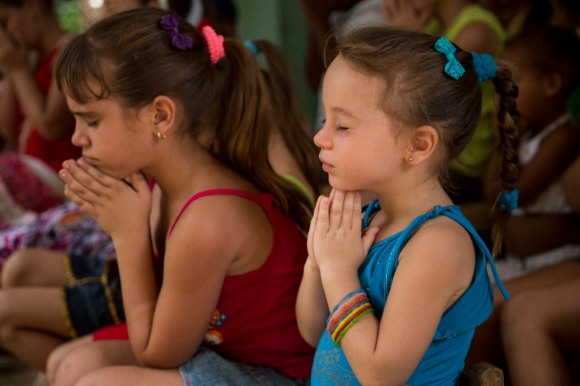 Cuban children learn to pray during a weekly meeting held in the home of two ladies with a passion to evangelize children. In 2010, the religious affiliation of Cuba was estimated by the Pew Forum to be 59.2 percent Christian (mostly Roman Catholic), 23.0 percent unaffiliated, 17.4 percent folk religion and the remaining 0.4 percent other religions. Wilson Hunter/IMB