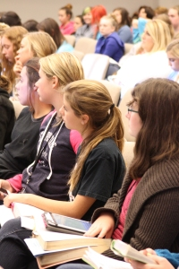 Students at AWSOM listen to Bible study leader Courtney Veasey.