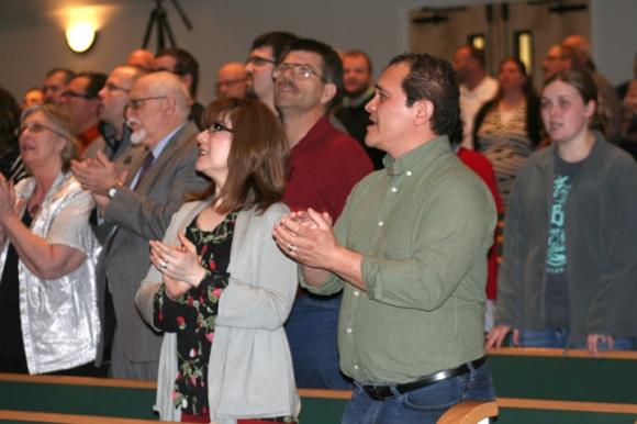 Letty and Luis Olmos of Iglesia Principe de Paz, Springfield, worship alongside other New Awakening Evangelism Conference attenders in Decatur.