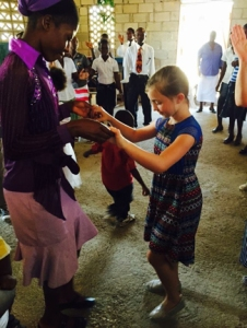 On a recent mission trip to Haiti, Mackenzie Howell, 9, worshiped in the church she helped build after a massive earthquake.