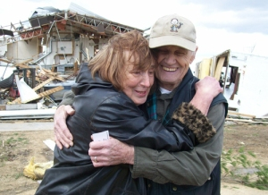 Raymond and Betty Kramer hug each other after being interviewed by the media about their experience in a Rochelle, IL restaurant's storm cellar while a tornado was on the ground above them. This photo was taken during and interview  in the town of Fairdale, IL, which was completely destroyed by tornado April 9.