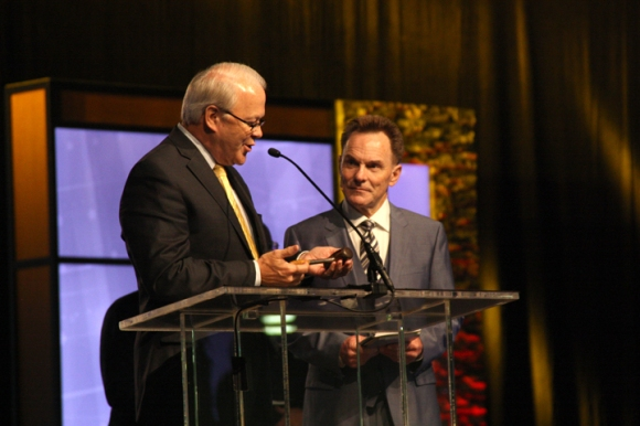 SBC Executive Committee President Frank Page (left) passes the Broadus gavel to SBC President Ronnie Floyd to start the business session.