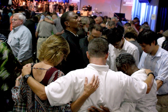 Prayer takes center stage (and all available floor space) as Marvin Parker, pastor of Broadview Missionary Baptist Church in Metro Chicago, and his wife, Inez, join with others in Columbus to pray for racial reconciliation.