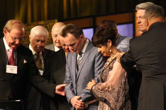 Past presidents of the Southern Baptist Convention pray for Ronnie Floyd and his wife, Jeana, prior to Floyd's president's address Tuesday morning.