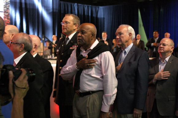 Robert Walker (third from right) leads the pledge of allegiance with other military veterans. Walker is missions pastor at Broadview Missionary Baptist Church in Chicago.