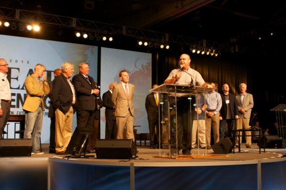 Jim Breeden, director of missions for the St. Louis Metro Baptist Association, accepts the hand-off for the 2016 Southern Baptist Convention.