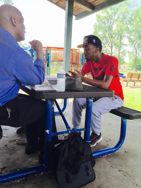The Uptown team taught classes, prayerwalked, and shared the gospel one-on-one.  Above, IBSA zone consultant Steven Glover (left) shares his faith  with a young man from Somalia.