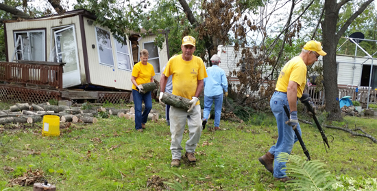 Disaster Relief volunteers clean up tornado damage at Woodhaven Lakes Camping Resort in Sublette.