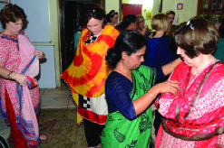 A whirl of color – The Illinois mission team tries on pieces of the sari indigenous to the culture.