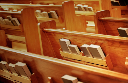 Church pews with hymnals