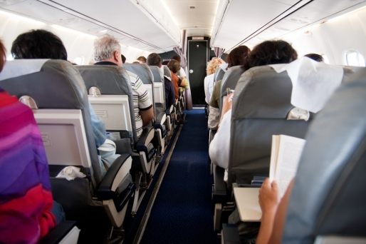 Interior of airplane with people inside