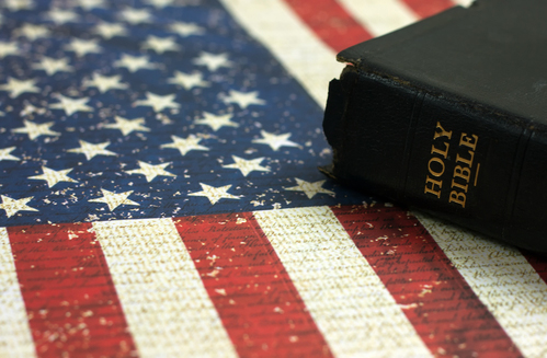 Old Holy Bible and the American Flag