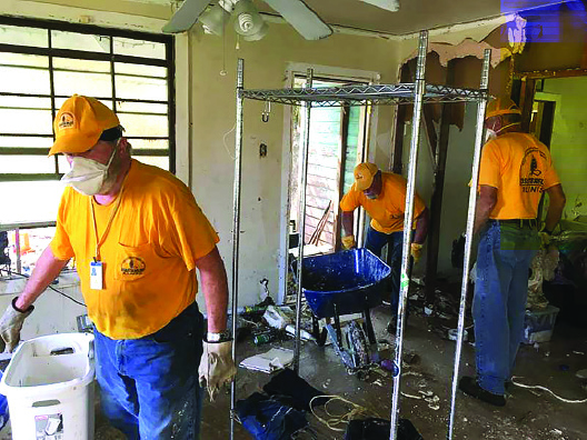 FBC Galatia flood recovery volunteers do mud-out work on a house in Vidor, Texas, near Beaumont.
