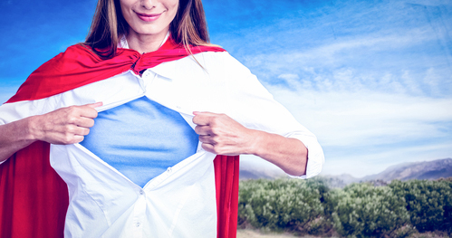Composite image of woman pretending to be superhero