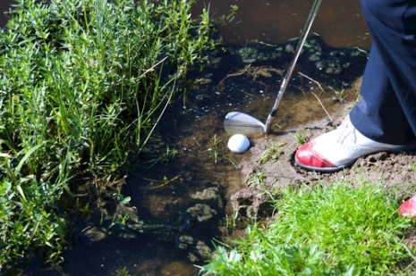 Difficult golf ball in the mud
